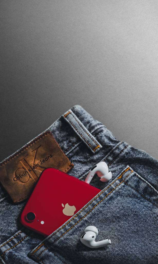 red and white card on blue denim jeans